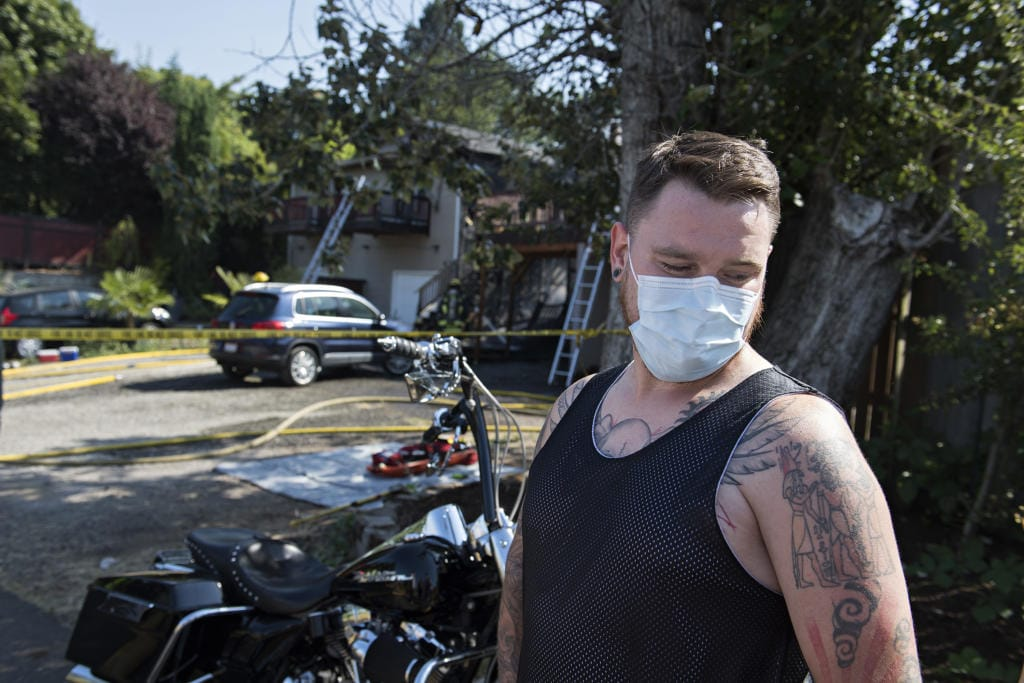 Tenant Josh Durrett escaped the fire and helped a neighbor escape the blaze as two adjoining duplexes on Olive Street went up in flames on Friday morning, July 31, 2020.