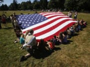Fort Vancouver celebrates the U.S. flag during the annual Fort Vancouver National Trust Flag Day.