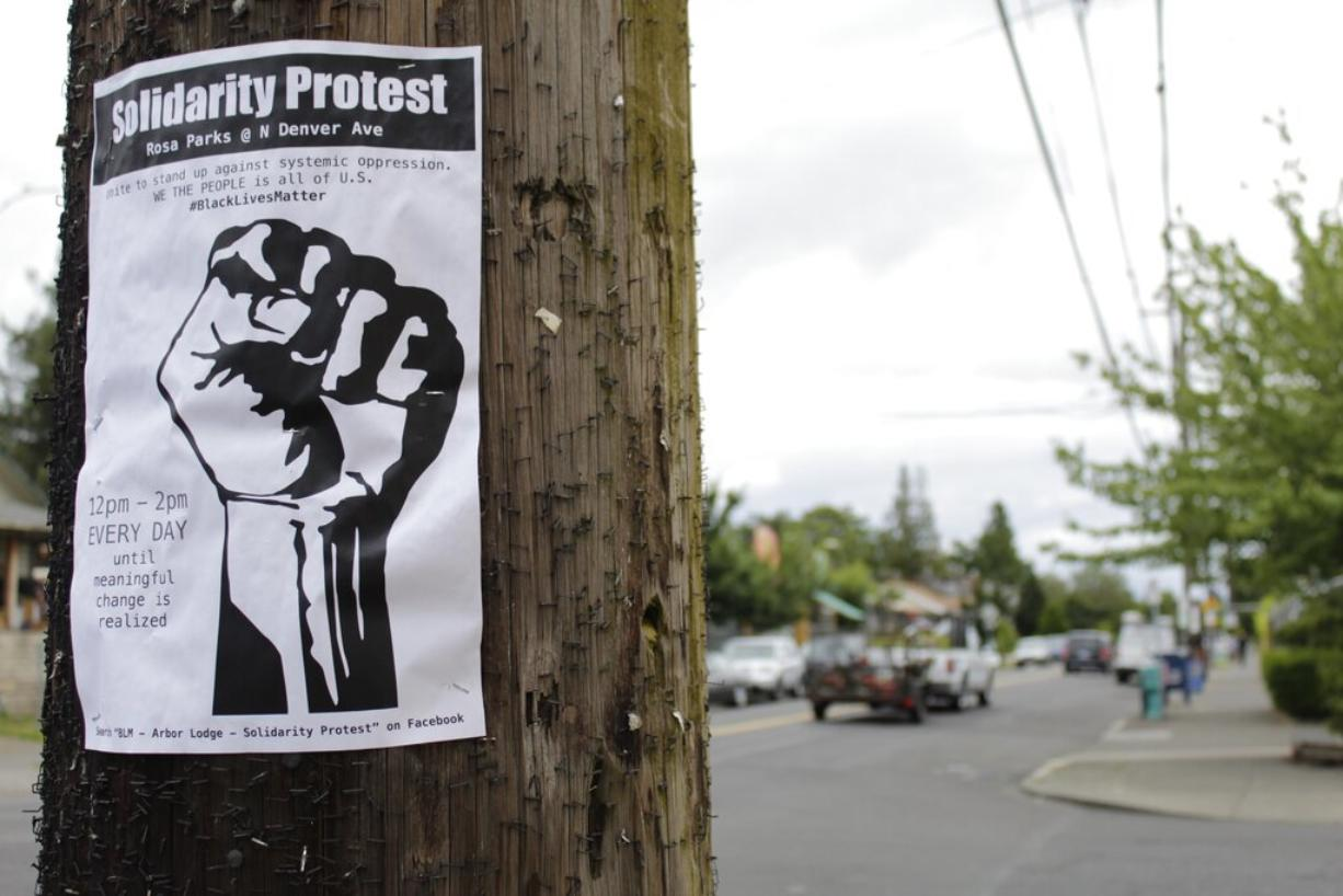 A sign advertising a daily protest in solidarity with Black Lives Matter is affixed to a telephone pole in a historically Black neighborhood in Portland, Ore., on Wednesday, July 1 2020. Thousands of protesters in the liberal and predominantly white city have taken to the streets peacefully every day for more than five weeks to decry police brutality, but recent violence by smaller groups is creating a deep schism in the protest movement and prompting allegations that white protesters are co-opting the moment.