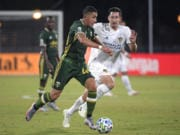 Portland Timbers midfielder Marvin Loria (44) controls the ball in front of LA Galaxy midfielder Sacha Kljestan during the first half of an MLS soccer match Monday, July 13, 2020, in Kissimmee, Fla. (AP Photo/Phelan M.