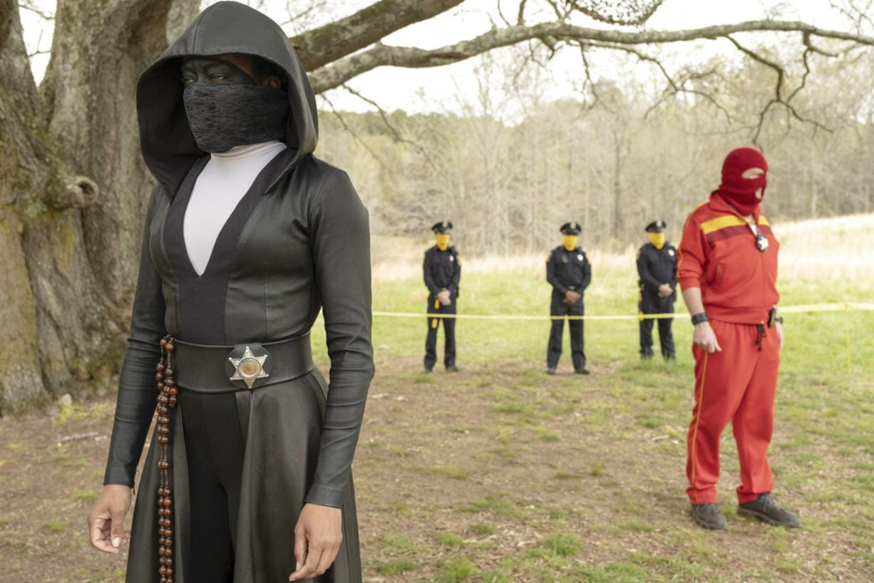 """This image released by HBO shows Regina King in a scene from """"Watchmen."""" (Mark Hill/HBO via AP)"""