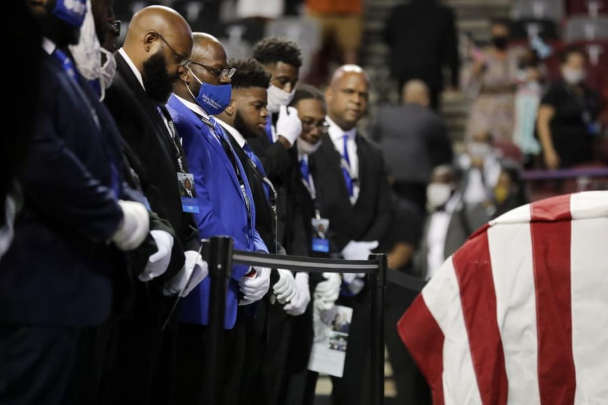 "Fraternity members sing in front of the casket of the late Rep. John Lewis, D-Ga., during a service celebrating ""The Boy from Troy"" at Troy University on Saturday, July 25, 2020, in Troy, Ala. Lewis, who carried the struggle against racial discrimination from Southern battlegrounds of the 1960s to the halls of Congress, died Friday, July 17, 2020."