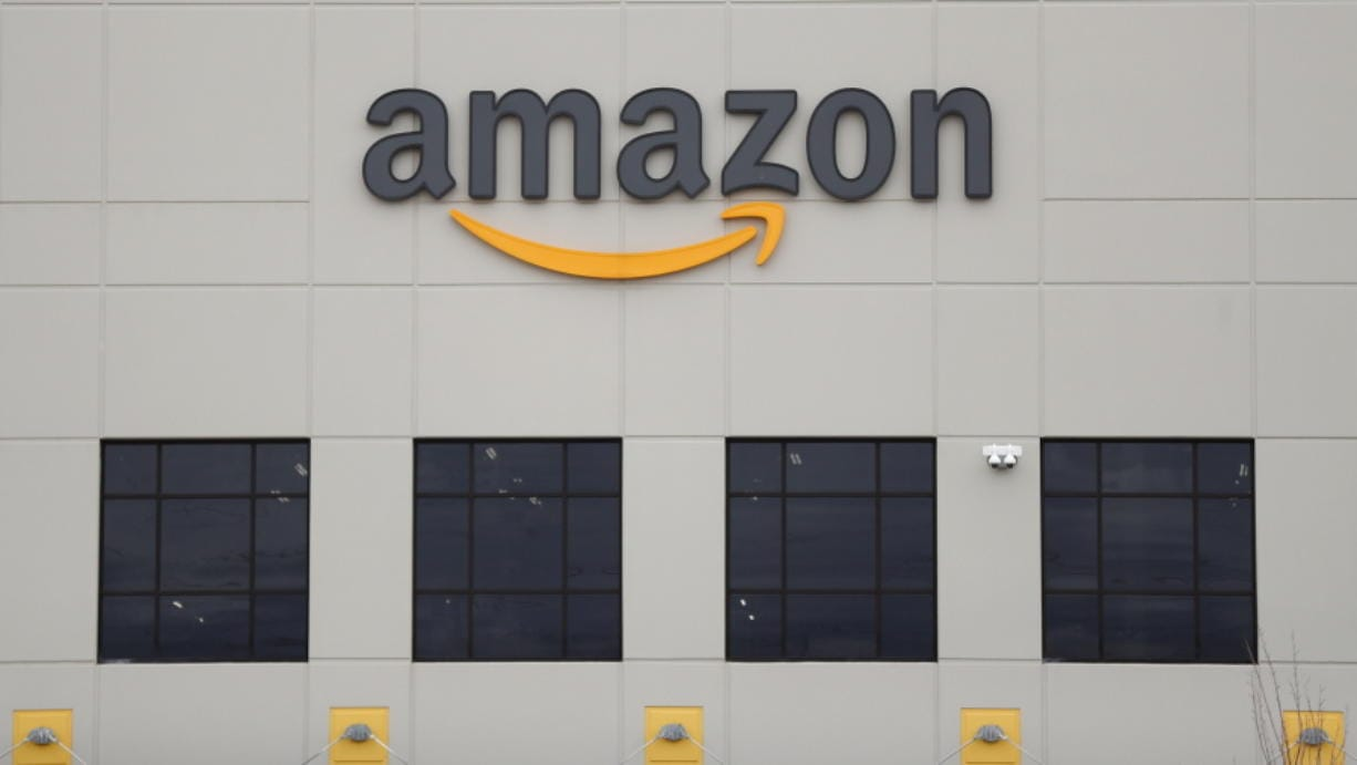 FILE - The Amazon DTW1 fulfillment center is shown in Romulus, Mich.  Amazon is heading to space. The online shopping giant received government approval to put more than 3,200 satellites into orbit that would beam down internet service to earth. Amazon said the satellites could provide internet to parts of the world that don't have it.