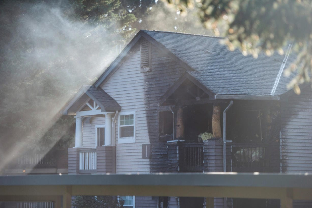 Burn marks show the extent of a fire at the Autumn Chase Apartments in Vancouver on Wednesday evening. Four people were injured in the fire.