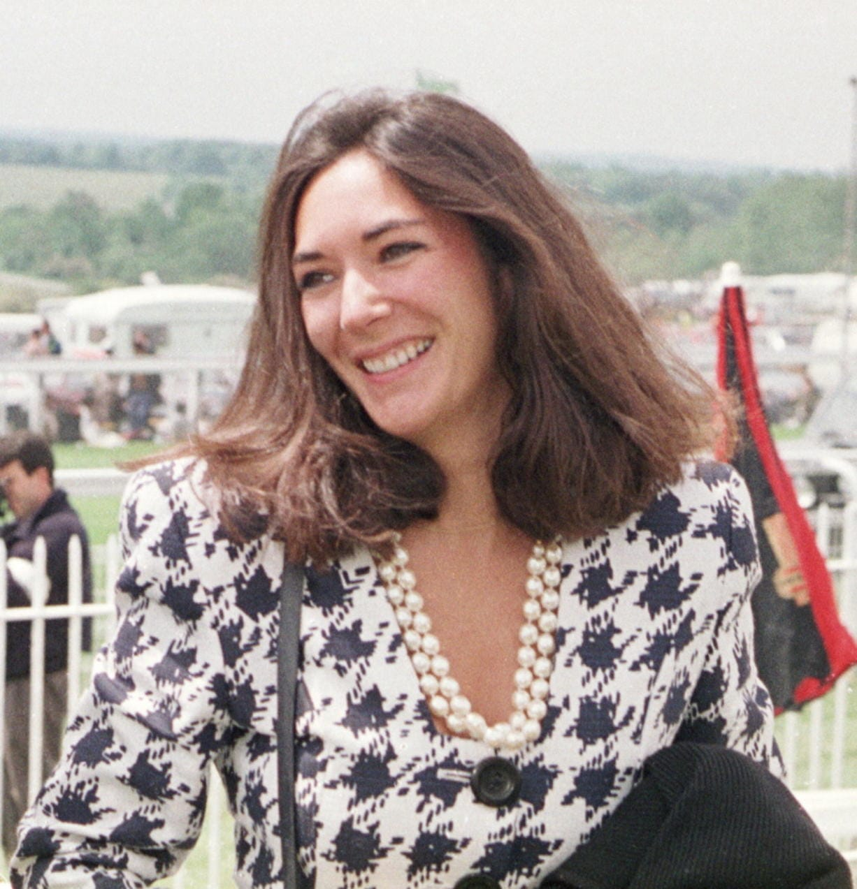 FILE - In this June 5, 1991 file photo, British socialite Ghislaine Maxwell arrives at Epsom Racecourse. Jeffrey Epstein's former girlfriend will face a judge and at least one of her accusers by video at a hearing to determine whether she stays behind bars until trial on charges she recruited girls for the financier to sexually abuse a quarter-century before he killed himself in a Manhattan jail. The hearing Tuesday, July 14, 2020, in Manhattan federal court was expected to feature a not guilty plea by Maxwell along with arguments over whether she'll flee if she's released.