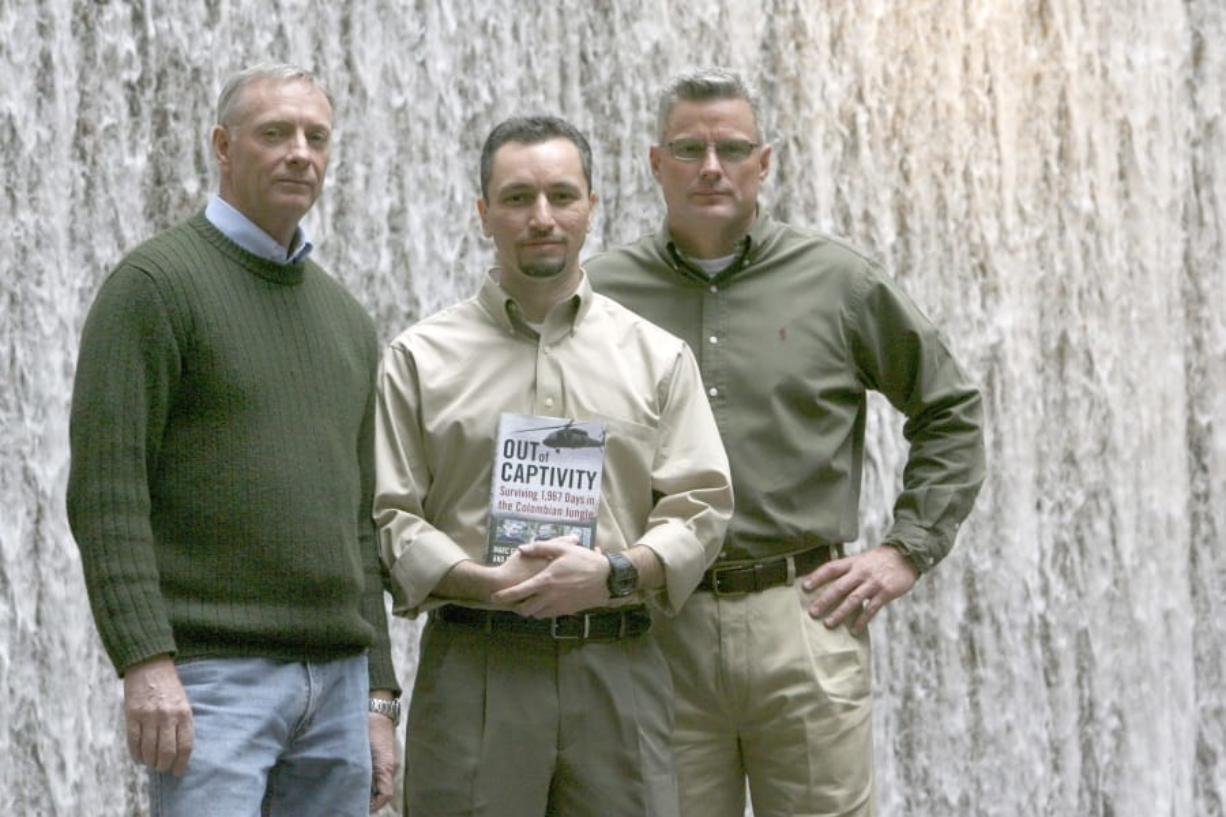 Former hostages, from left, Tom Howes, Marc Gonsalves and Keith Stansell are shown in 2009. The American defense contractors were held for years by leftist rebels in Colombia.