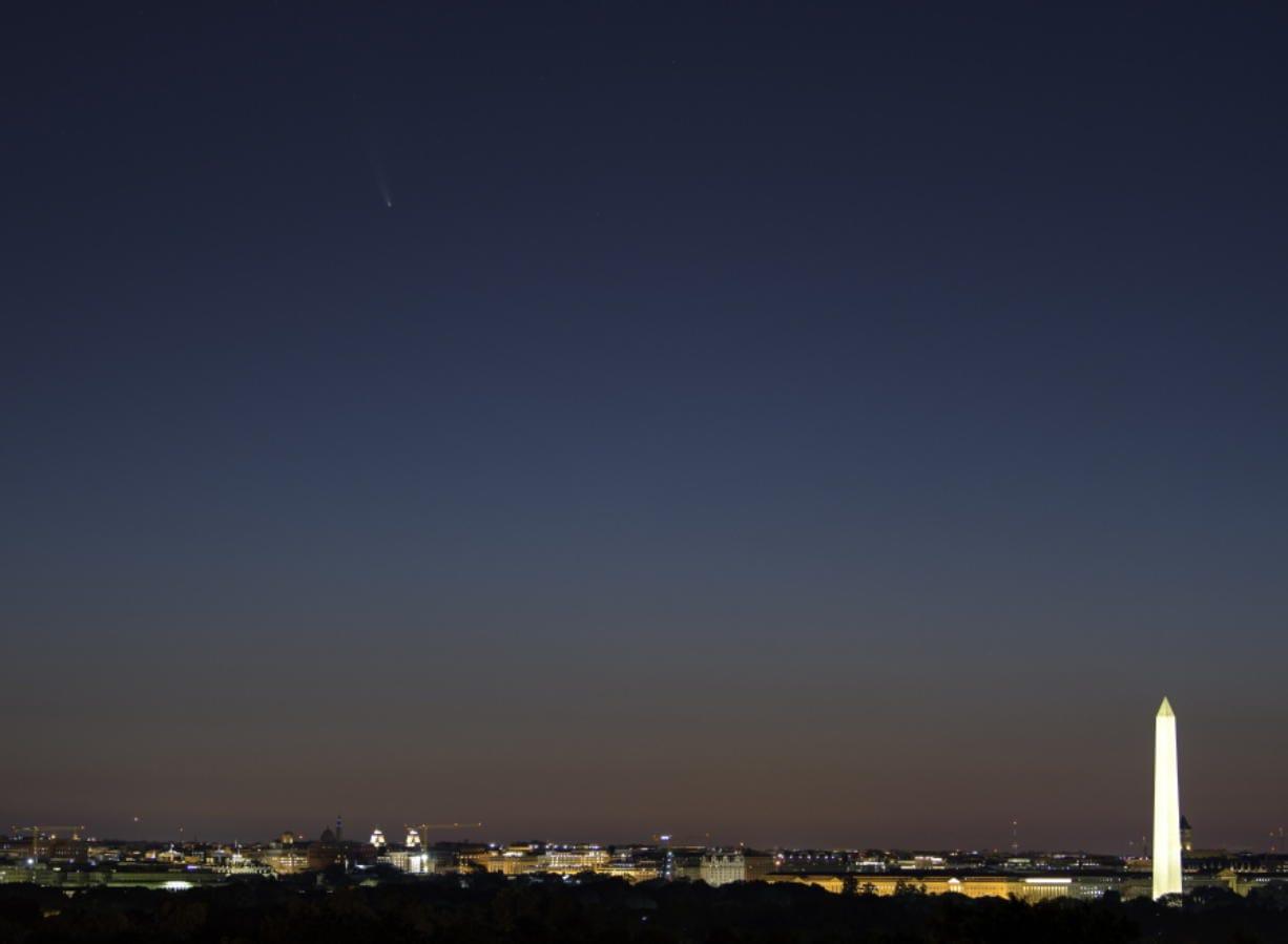Comet Neowise, upper left, is seen before sunrise over Washington, D.C. last week.