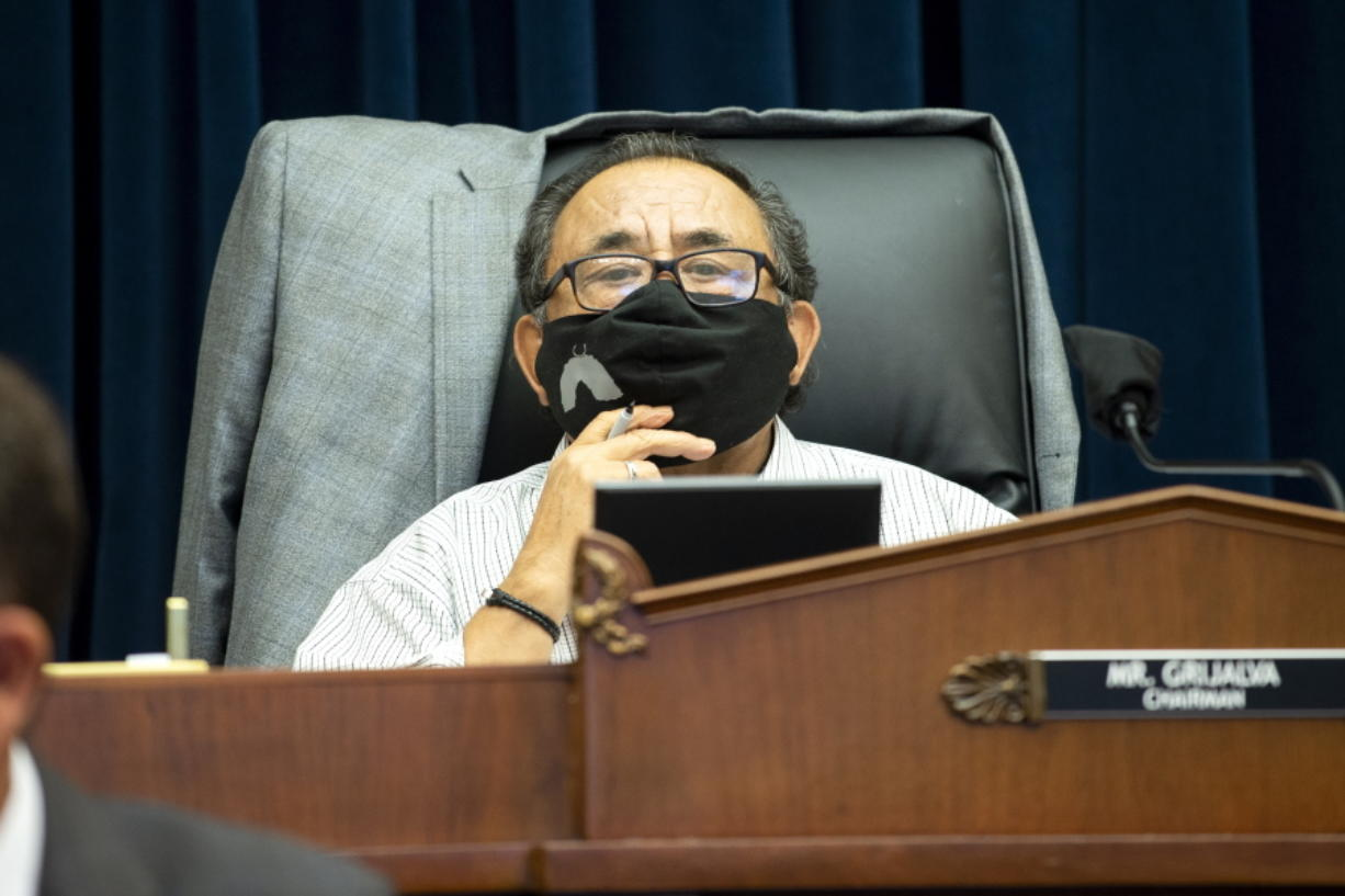 FILE - In this June 29, 2020 file photo, Committee Chairman Rep. Raul Grijalva, D-Ariz., listens on Capitol Hill in Washington, during the House Natural Resources Committee hearing.  A bipartisan bill that would spend nearly $3 billion on conservation projects, outdoor recreation and maintenance of national parks and other public lands is on its way to the president's desk after winning final legislative approval. Supporters say the measure, known as the Great American Outdoors Act, would be the most significant conservation legislation enacted in nearly 50 years.