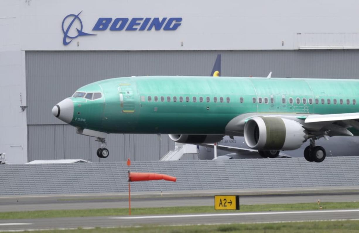 FILE - In this April 10, 2019, file photo a Boeing 737 MAX 8 airplane being built for India-based Jet Airways lands following a test flight at Boeing Field in Seattle.  Boeing says it lost $2.40 billion in the second quarter, and it's taking a more downbeat view about the airplane market because of the coronavirus outbreak. Boeing said Wednesday, July 29, 2020, it now expects the airline industry will take longer to recover from the pandemic, and that will limit aircraft sales. (AP Photo/Ted S.