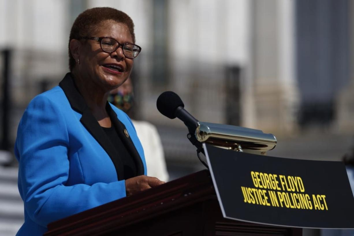 FILE - In this June 25, 2020, file photo Rep. Karen Bass, D-Calif., speaks during a news conference on the House East Front Steps on Capitol Hill in Washington ahead of the House vote on the George Floyd Justice in Policing Act of 2020. California Congresswoman Bass has emerged a leading contender to be Democrats' vice presidential candidate. Allies say her reputation as a bridge-builder would make her a strong partner to presumptive Democratic presidential nominee.