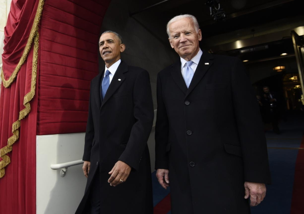 FILE - In this Jan. 20, 2017, file photo, President Barack Obama and Vice President Joe Biden arrive for the Presidential Inauguration of Donald Trump at the U.S. Capitol in Washington. 2020 presidential candidate and former Vice President Biden is releasing a video of his first in-person meeting with former President Obama since the coronavirus outbreak began, enlisting the former president to help slam his successor's response to the pandemic.