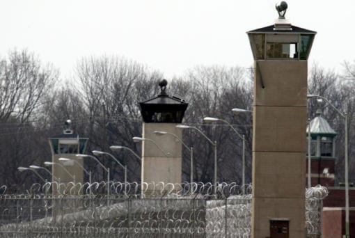 FILE - In this March 17, 2003 file photo, guard towers and razor wire ring the compound at the U.S. Penitentiary in Terre Haute, Ind., the site of the last federal execution. After the latest 17-year hiatus, the Trump administration wants to restart federal executions this month at the Terre Haute, prison. Four men are slated to die. All are accused of murdering children in cases out of Arkansas, Kansas Iowa and Missouri.