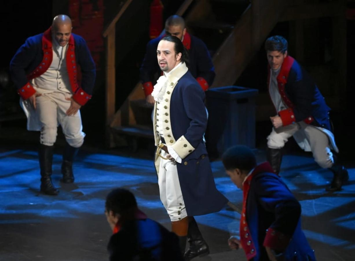 "Lin-Manuel Miranda and the cast of ""Hamilton"" perform June 12, 2016, at the Tony Awards in New York. A filmed version of the original Broadway production will be available today on Disney Plus."
