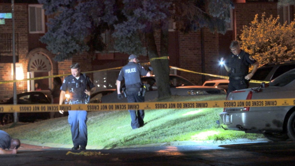 Police establishe a large crime scene in the 330 block of Craig Drive in Hammond, Ind., Wednesday night, July 29, 2020 as they investigate a shooting that left a 2-year-old in critical condition.