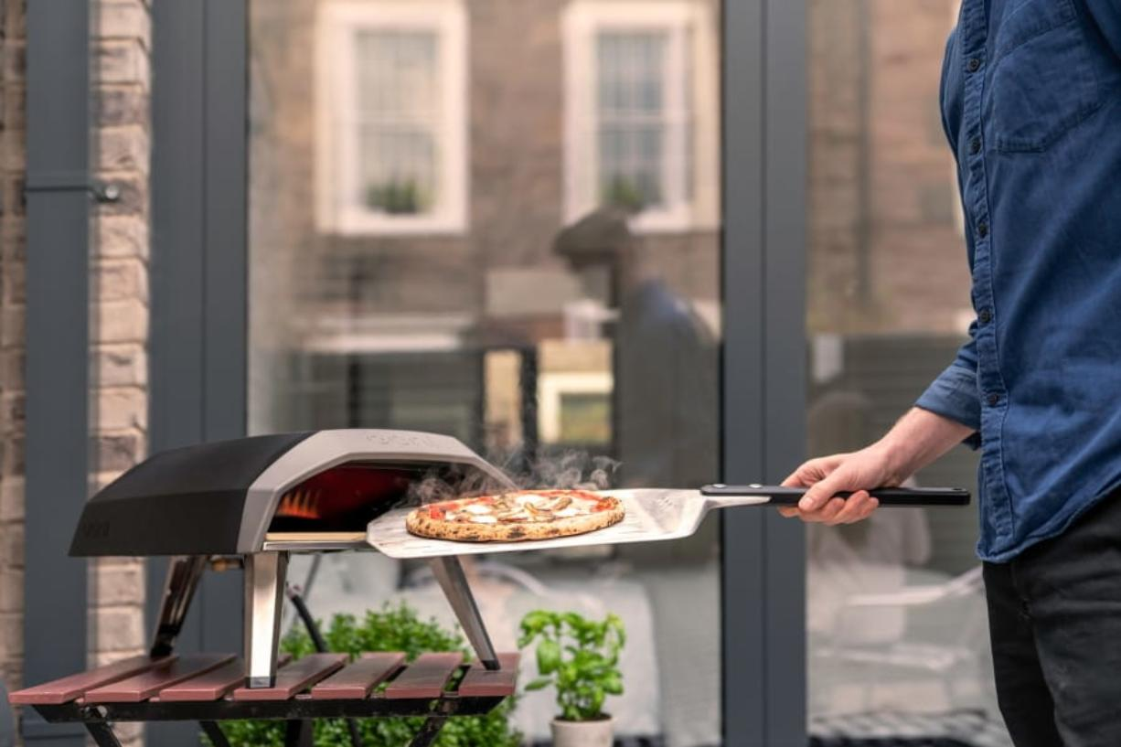 The handy Ooni Koda propane pizza grill, that's ready to go in 15 minutes and cooks pizza in about a minute - as well as roasted fish, steak or vegetables.