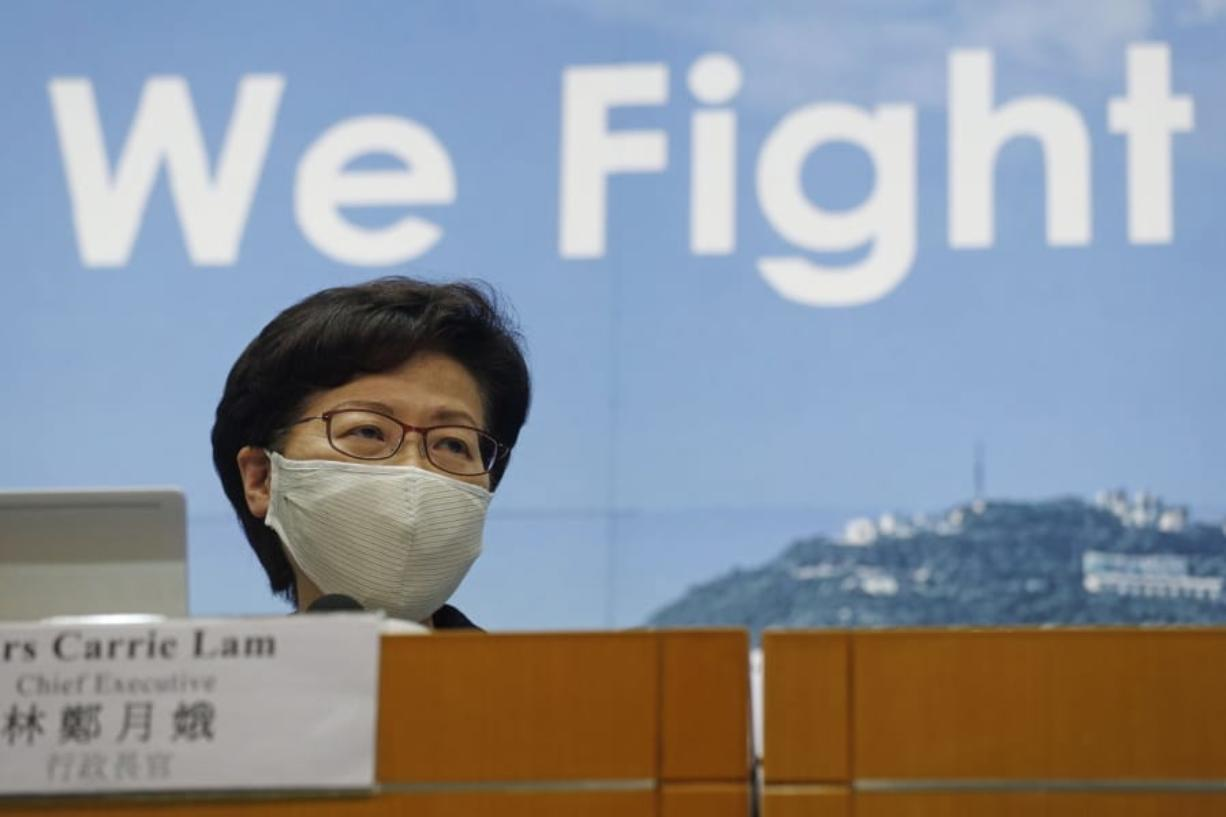 Hong Kong Chief Executive Carrie Lam speaks during a press conference in Hong Kong, Friday, July 31, 2020. She announced to postpone legislative elections scheduled for Sept. 6, citing a worsening coronavirus outbreak.
