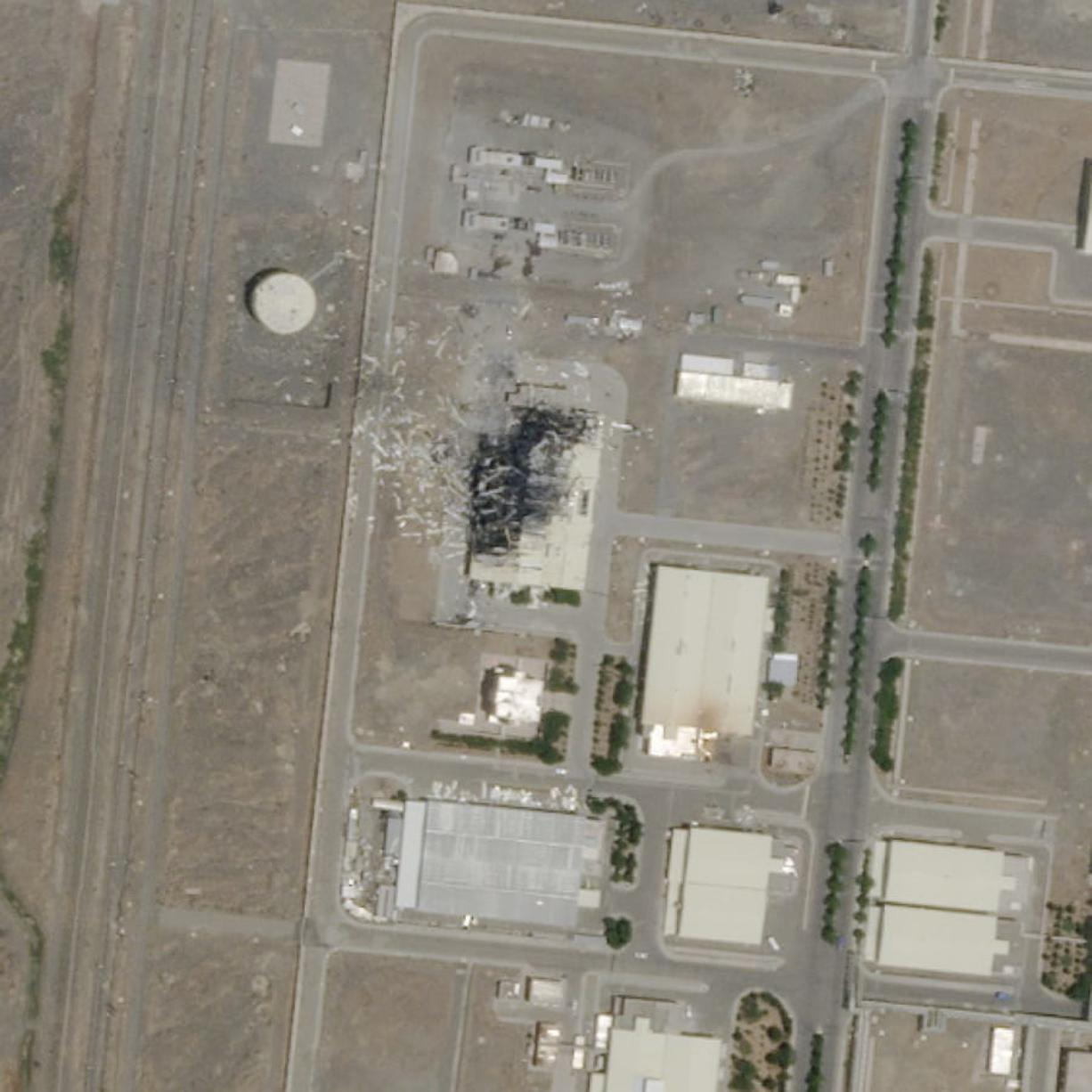 This Sunday, July 5, 2020 satellite image from Planet Labs Inc. shows the substantial damage done by an explosion and a fire at an advanced centrifuge assembly plant at Iran's Natanz nuclear site. Israeli leaders are now hinting it was behind the massive fire at the Iranian nuclear site last week, potentially ratcheting up a long-running covert war. (Planet Labs Inc.