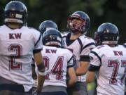 King's Way players celebrate after an interception in the first quarter at Kiggins Bowl on Thursday evening, Aug. 31, 2017.