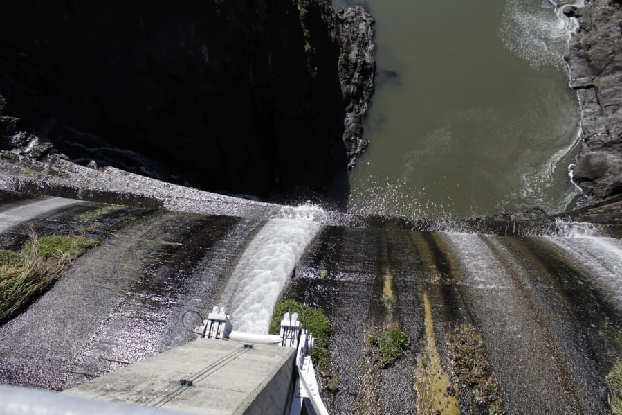 Excess water spills over the top of a dam on the lower Klamath River known as Copco 1 near Hornbrook, Calif.