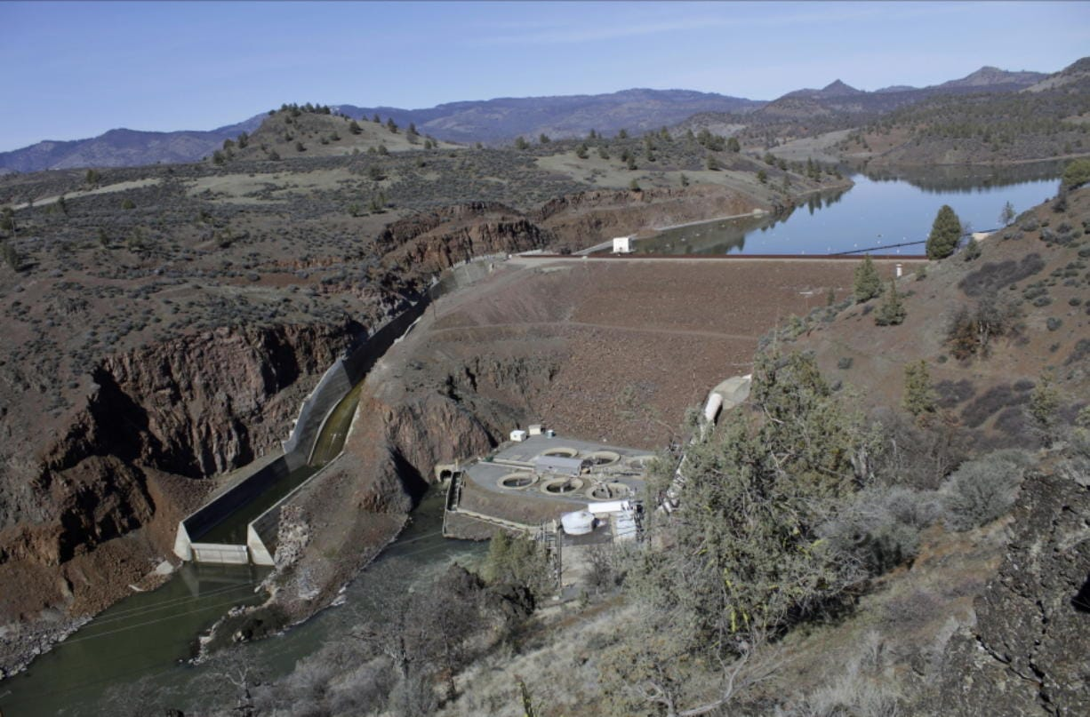 FILE - This March 3, 2020, file photo shows the Iron Gate Dam, powerhouse and spillway are on the lower Klamath River near Hornbrook, Calif. California Gov. Gavin Newsom has appealed directly to investor Warren Buffet to support demolishing four hydroelectric dams on a river along the Oregon-California border to save salmon populations that have dwindled to almost nothing. Newsom on Wednesday, July 28, 2020, wrote Buffet, urging him to back the Klamath River project, which would be the largest dam removal in U.S. history.