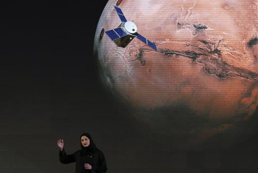 "FILE - In this Wednesday, May 6, 2015 file photo, Sarah Amiri, deputy project manager of the United Arab Emirates Mars mission, talks about the project named ""Hope,"" or ""al-Amal"" in Arabic, which is scheduled for launch in 2020, during a ceremony in Dubai, UAE. Three countries -- the United States, China and the United Arab Emirates -- are sending unmanned spacecraft to the red planet in quick succession beginning in July 2020."