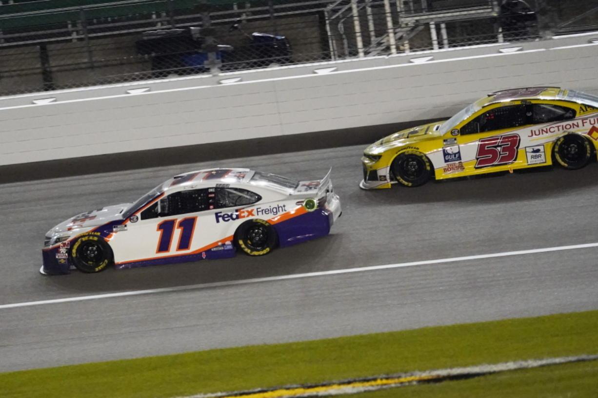 Denny Hamlin (11) battles Josh Bilicki (53) during a NASCAR Cup Series auto race at Kansas Speedway in Kansas City, Kan., Thursday, July 23, 2020.