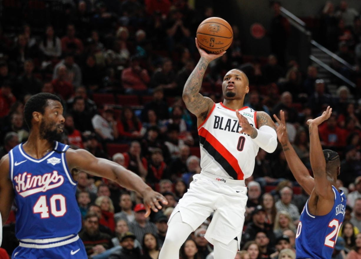 Portland Trail Blazers guard Damian Lillard (0) says he will spend most of his downtime working on recording music while inside the NBA bubble.