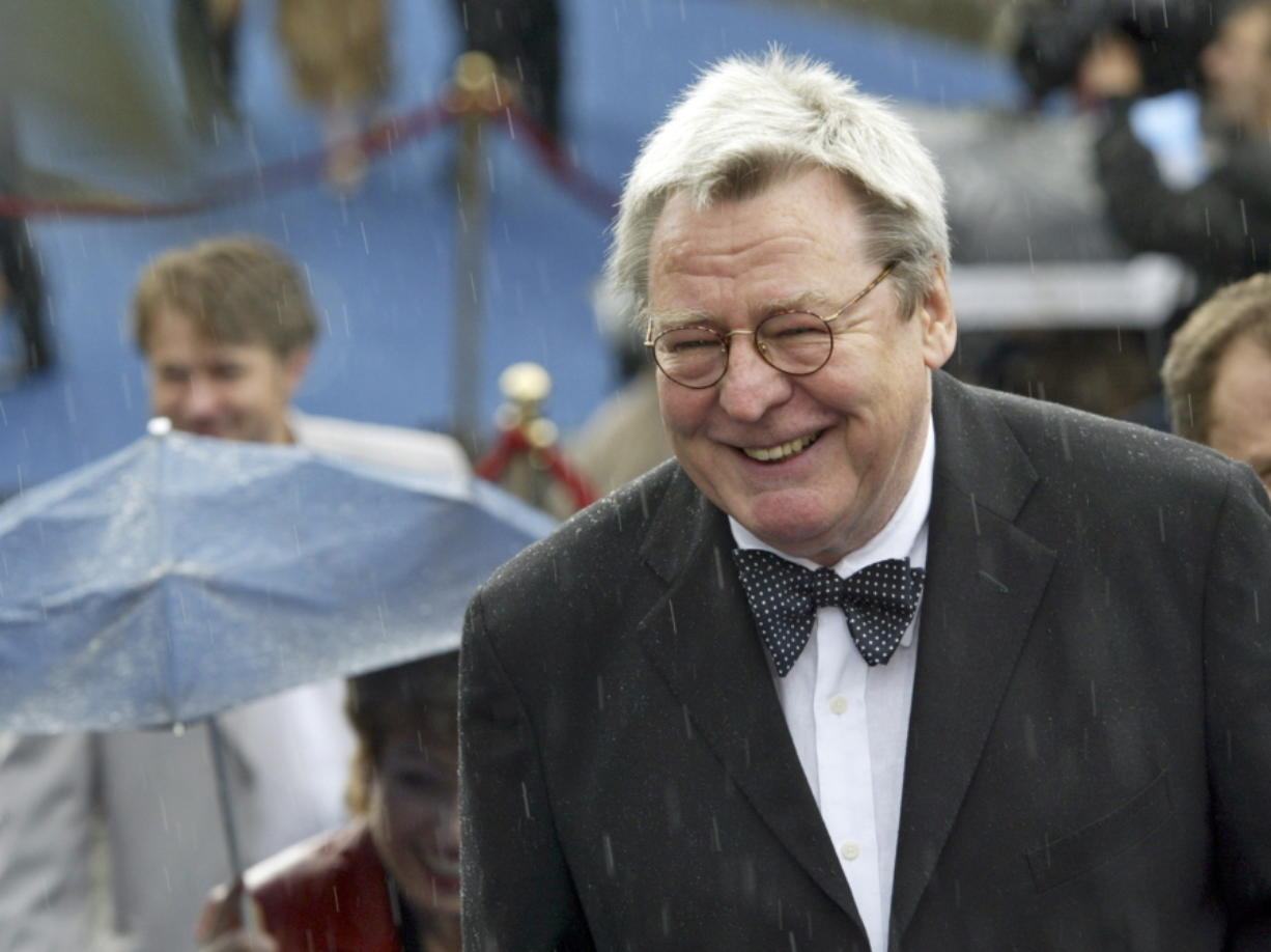 """FILE - Film director Alan Parker arrives at the opening ceremony of 26th Moscow International Film Festival in Moscow on June 18, 2004. Parker, whose movies included """"Bugsy Malone,"""" """"Midnight Express"""" and """"Evita,"""" has died at the age of 76. A statement from the director's family says Parker died Friday in London after a long illness."""