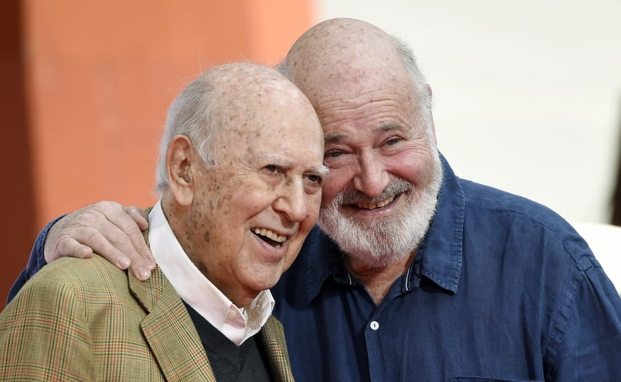 Carl Reiner, left, and his son Rob Reiner pose together April 7, 2017, following their hand and footprint ceremony at the TCL Chinese Theatre in Los Angeles. Carl Reiner died of natural causes on Monday night at his home in Beverly Hills, Calif. He was 98.