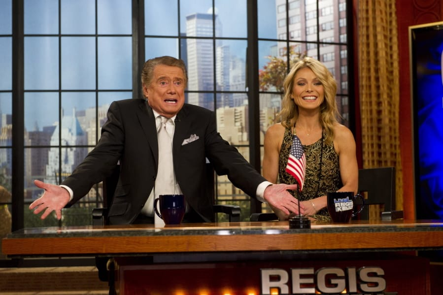 "Regis Philbin and Kelly Ripa appear Nov. 18, 2011, on Regis' farewell episode of ""Live! with Regis and Kelly,"" in New York. Philbin died July 24."