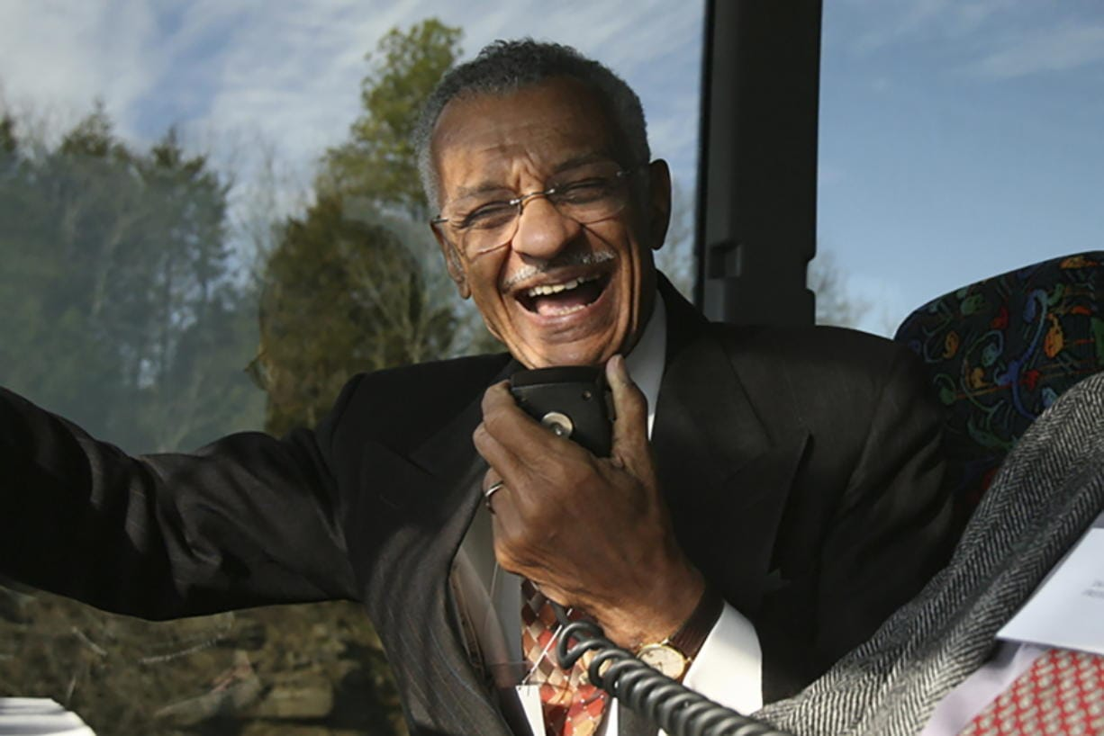 FILE - In this Jan. 27, 2007, file photo, C.T. Vivian uses an intercom with Rev. James Lawson on a bus in Montgomery, Ala., to discuss the experiences they encountered in 1961 as Freedom Riders, a group of college students who defied segregation on interstate buses across the American South. The Rev. Vivian, a civil rights veteran who worked alongside the Rev. Martin Luther King Jr. and served as head of the organization co-founded by the civil rights icon, has died at home in Atlanta of natural causes Friday morning, July 17, 2020 his friend and business partner Don Rivers confirmed to The Associated Press. Vivian was 95.