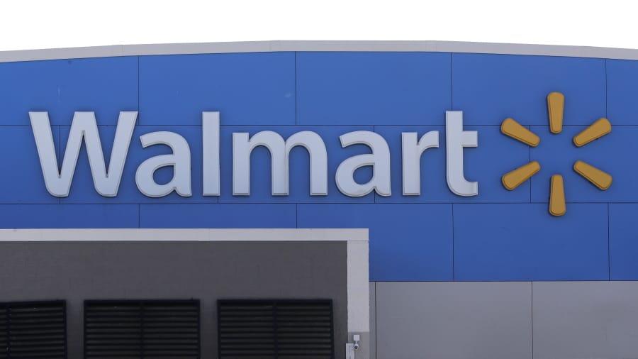 A Walmart logo is displayed outside of a Walmart store, in Walpole, Mass.