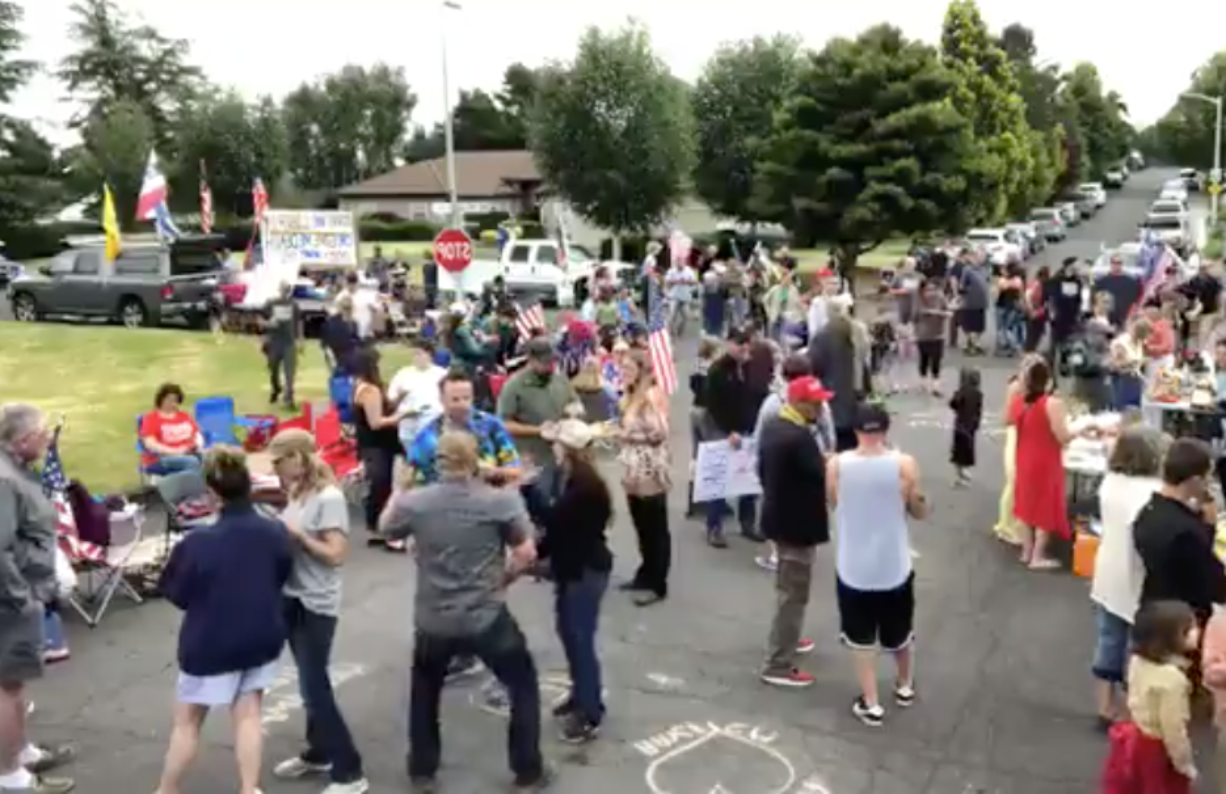 A screen shot from a Facebook Live video on People's Rights Washington's page shows a gathering of protesters outside Vancouver City Prosecutor Kevin McClure's home on Sunday.