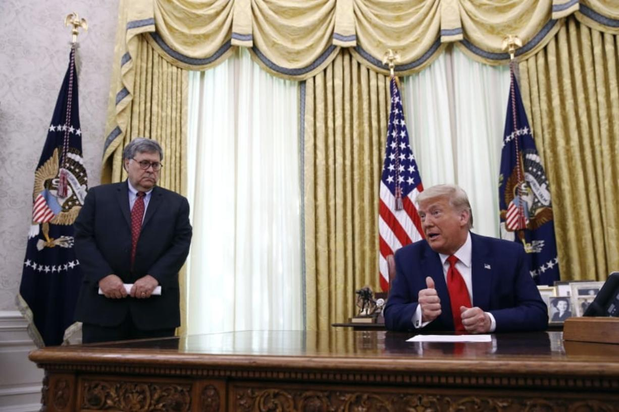 President Donald Trump speaks alongside Attorney General William Barr during a law enforcement briefing on the MS-13 gang in the Oval Office of the White House, Wednesday, July 15, 2020, in Washington.
