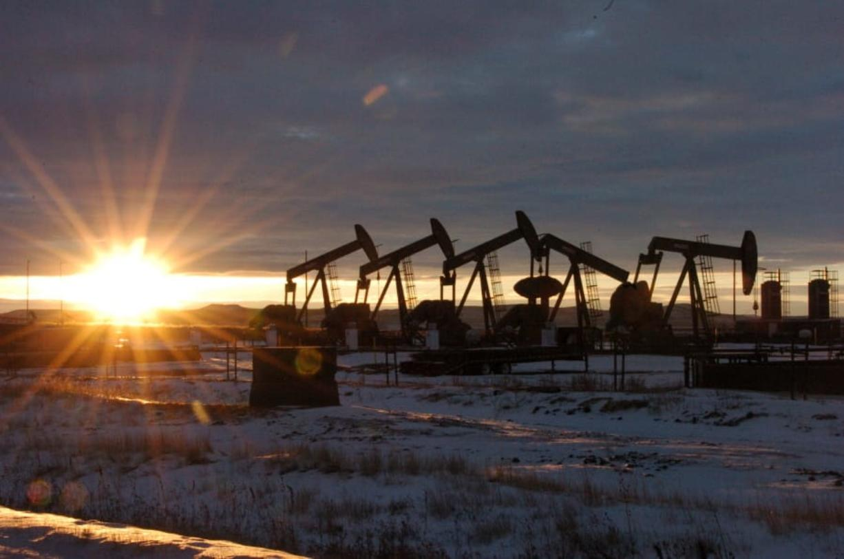 FILE - In this Jan. 14, 2015, file photo, oil pump jacks are seen in McKenzie County, in western North Dakota. The Trump administration is seeking to ease more rules for oil and gas drilling that were adopted under the Obama administration, with the latest changes projected to save energy companies almost $140 million over the next decade.