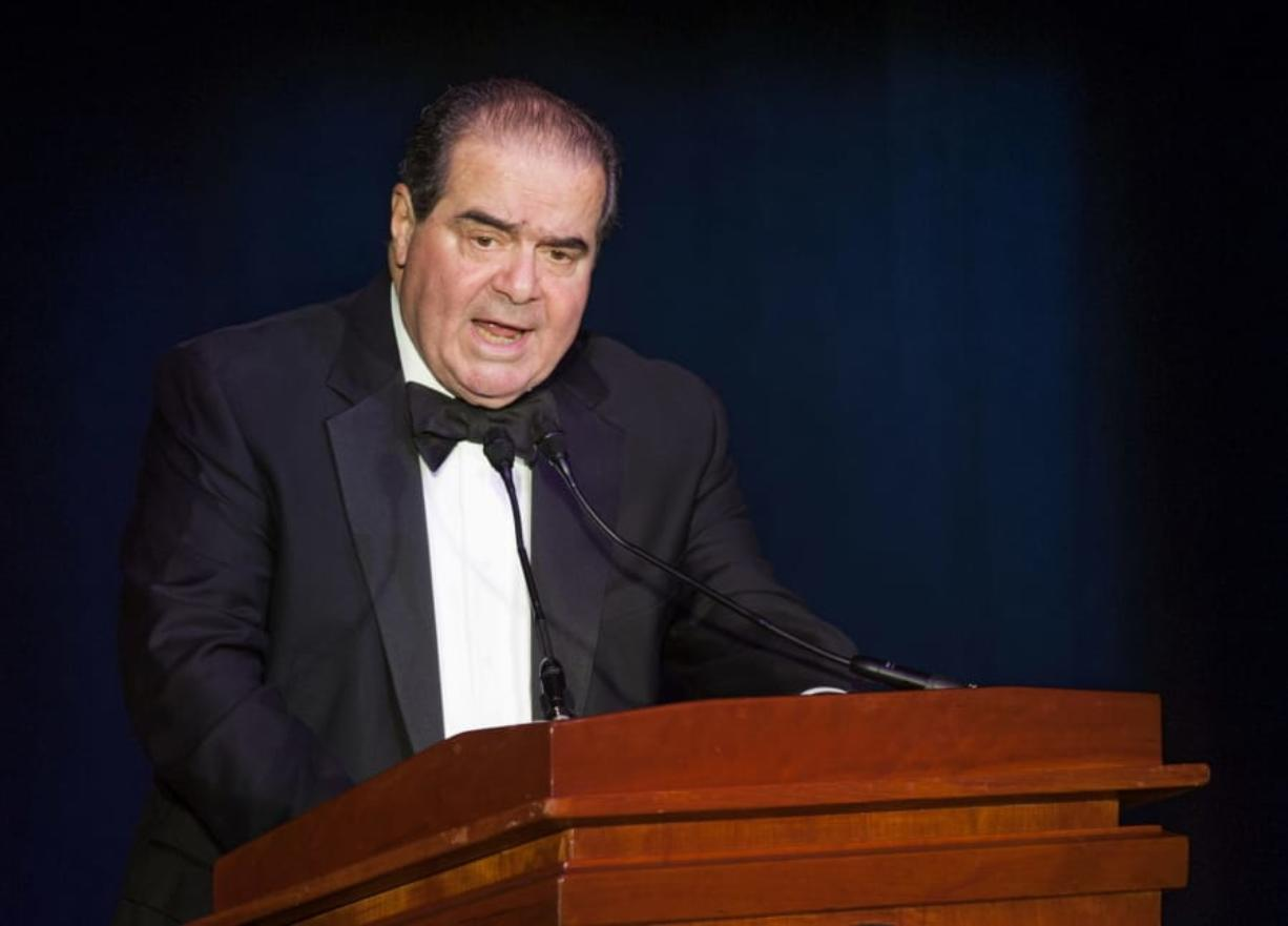 """FILE - In this Nov. 6, 2014, file photo Supreme Court Justice Antonin Scalia speaks in Washington. President Donald Trump has visions of establishing by the final months of his second term--should he win one--a """"National Garden of American Heroes"""" that will pay tribute to some of the prominent figures in the nation's history, including Justice Scalia, that he sees as the """"greatest Americans to ever live."""" The president unveiled his plan Friday, July 3, 2020, during his speech at Mount Rushmore National Memorial, S.D."""