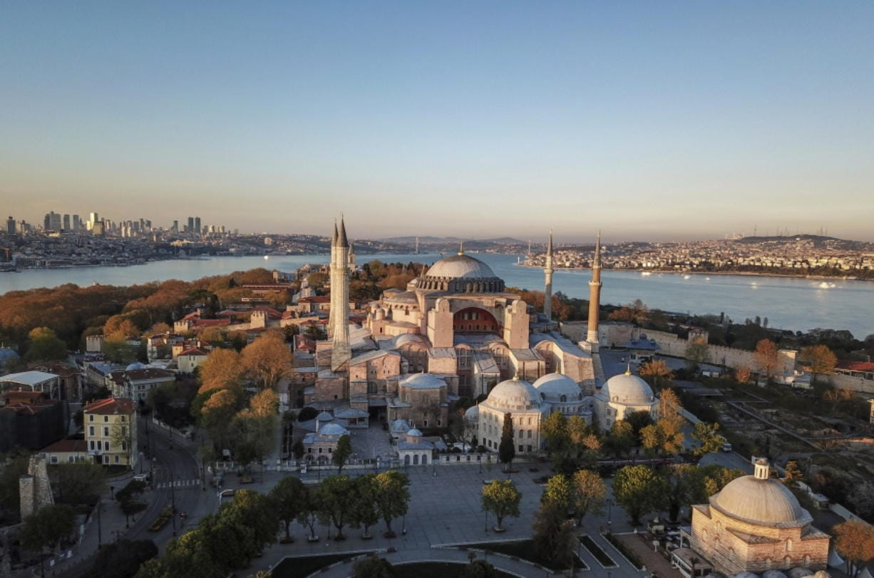 FILE-In this Saturday, April 25, 2020 file photo, an aerial view of the Byzantine-era Hagia Sophia, one of Istanbul's main tourist attractions in the historic Sultanahmet district of Istanbul.Turkey's Council of State on Friday, July 10, 2020, threw its weight behind a petition brought by a religious group and annulled a 1934 cabinet decision that changed the 6th century building into a museum. The ruling allows the government to restore the Hagia Sophia's previous status as a mosque.The decision was in line with the Turkish President's Recep Tayyip Erdogan's calls to turn the hugely symbolic world heritage site into a mosque despite widespread international criticism, including from the United States and Orthodox Christian leaders.