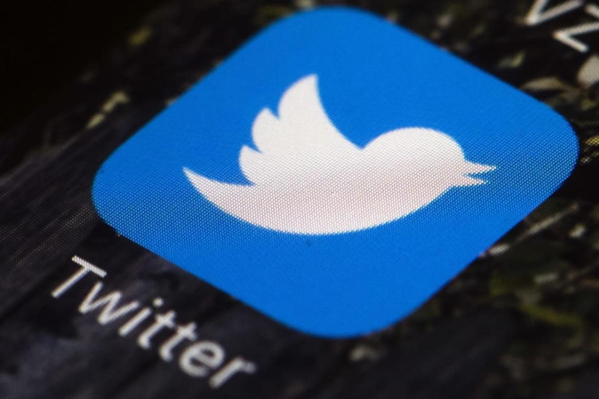 FILE - This April 26, 2017, file photo shows the Twitter app icon on a mobile phone in Philadelphia. Former Ku Klux Klan leader David Duke has been banned from Twitter for breaking the social media platform's site's rules forbidding hate speech.