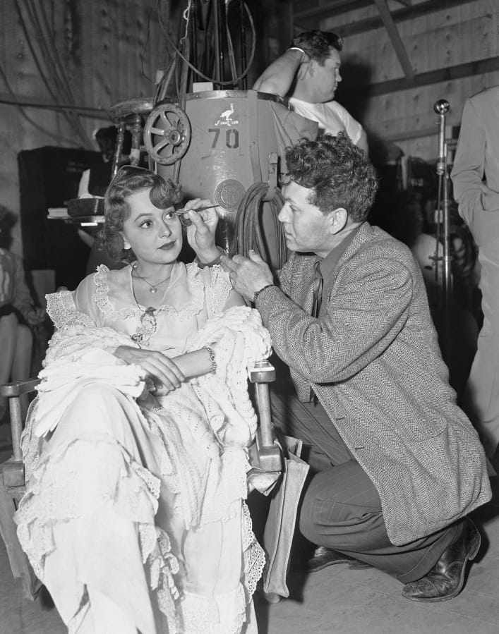 """Actress Olivia de Havilland has makeup applied July 21, 1946, on the set of the movie""""To Each His Own."""" (Associated Press files)"""