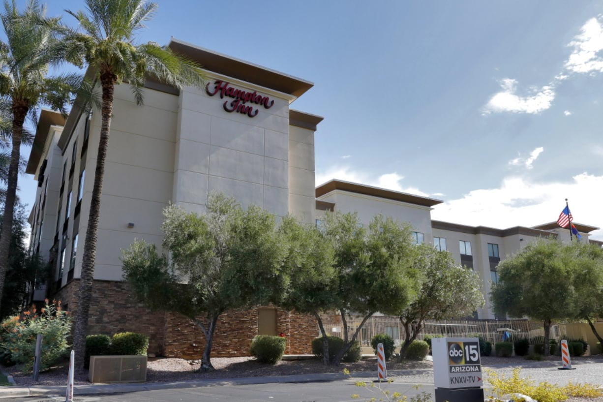 A Hampton Inn is shown Tuesday, July 21, 2020 in Phoenix.  The Trump administration is detaining immigrant children as young as 1 in hotels before deporting them to their home countries. Documents obtained by The Associated Press show a private contractor hired by U.S. Immigration and Customs Enforcement is taking children to three Hampton Inns in Arizona and Texas under restrictive border policies implemented during the coronavirus pandemic.