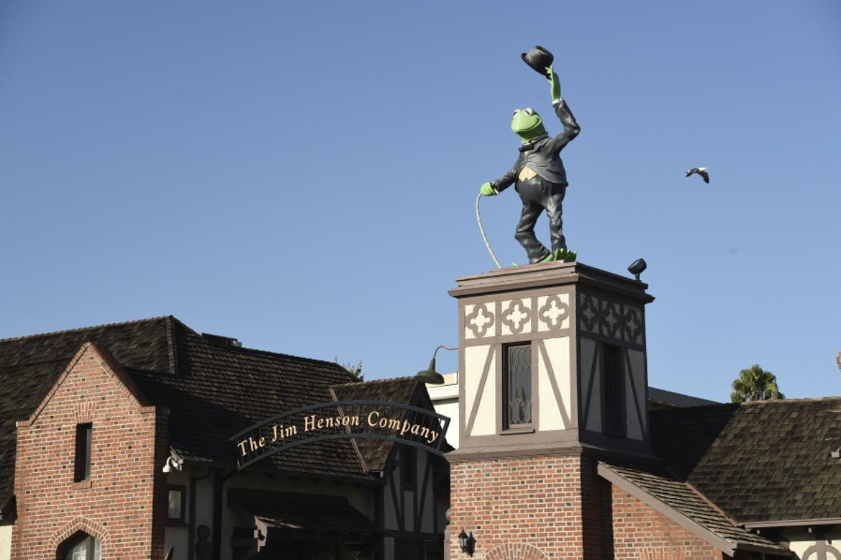 A statue of Kermit The Frog stands at the entrance to The Jim Henson Company, Tuesday, July 7, 2020, in the Hollywood section of Los Angeles. The U.S. government's small business lending program sent pandemic relief money into unexpected corners of the entertainment industry. The Muppet makers say they received about $2 million to keep their 75 workers employed through the coronavirus shutdown.