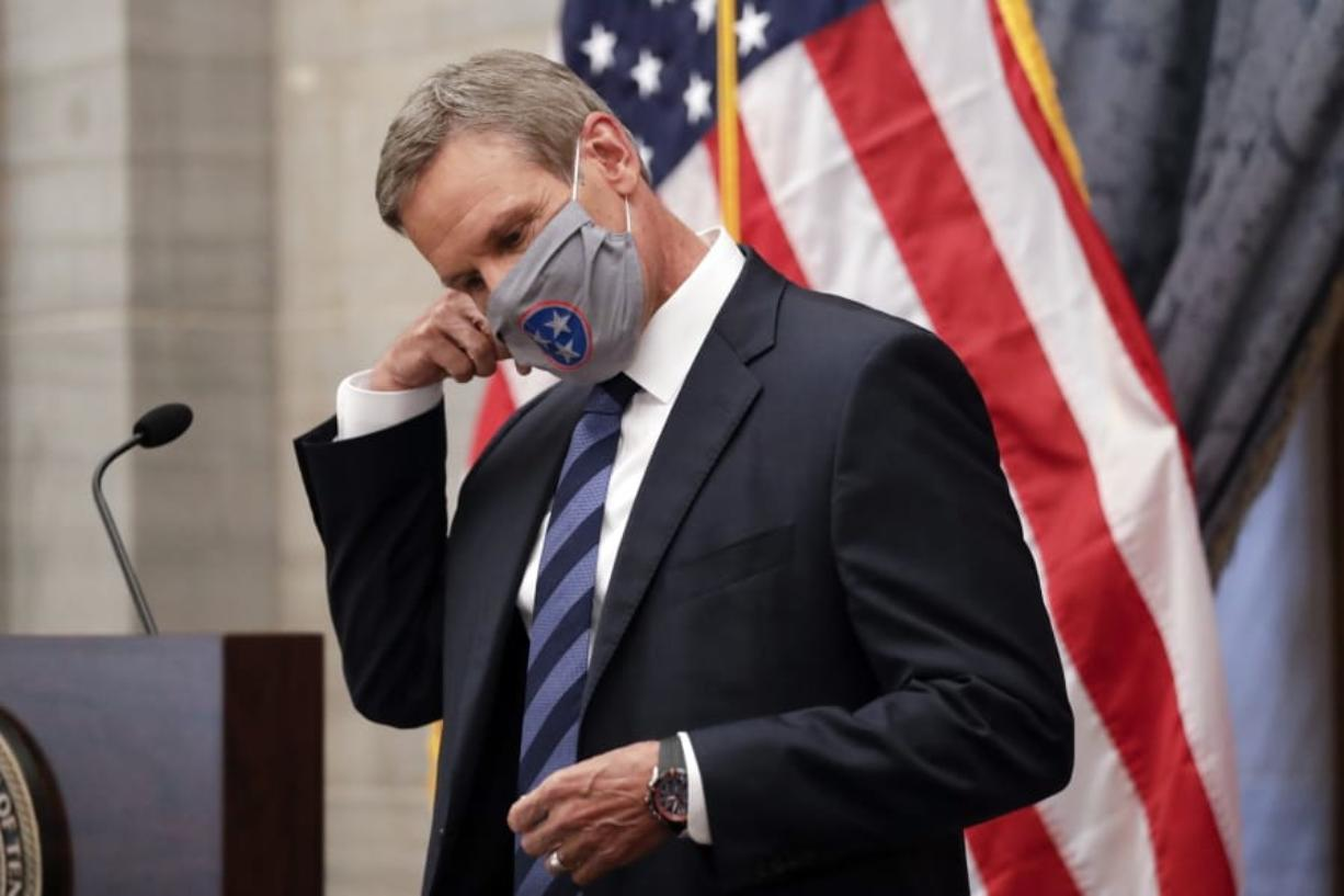 Tennessee Gov. Bill Lee removes his mask as he begins a news conference Wednesday, July 1, 2020, in Nashville, Tenn.