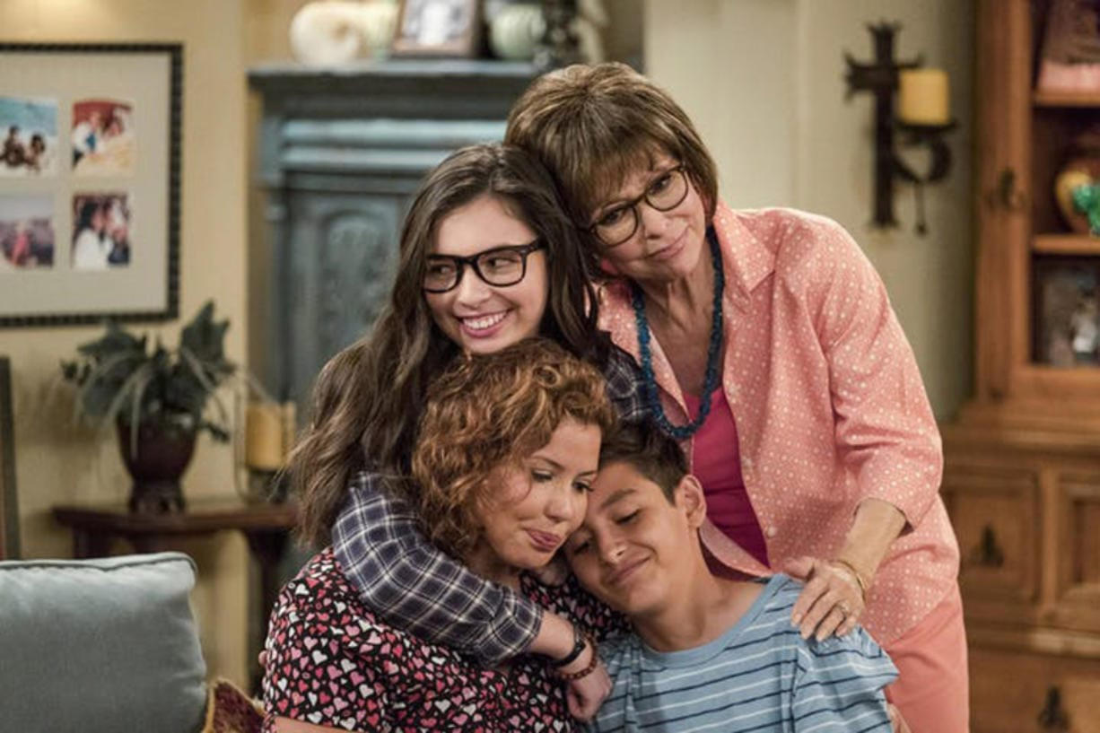 """The cast of """"One Day at a Time"""" includes, clockwise from bottom left: Justina Machado, Isabella Gomez, Rita Moreno and Marcel Ruiz.(Adam Rose/ Netflix/TNS)"""