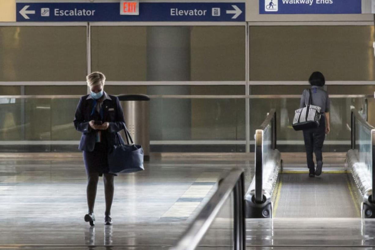 An American Airlines employee walked out of Terminal D at DFW International Airport on July 26, 2020. (Lynda M.