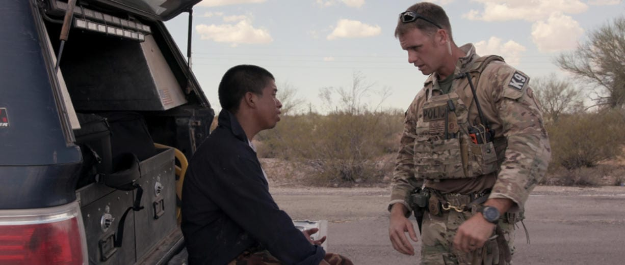 """A migrant, left, seeks help in Tucson's desert in a moment from Netflix's """"Immigration Nation."""" (Netflix/TNS)"""