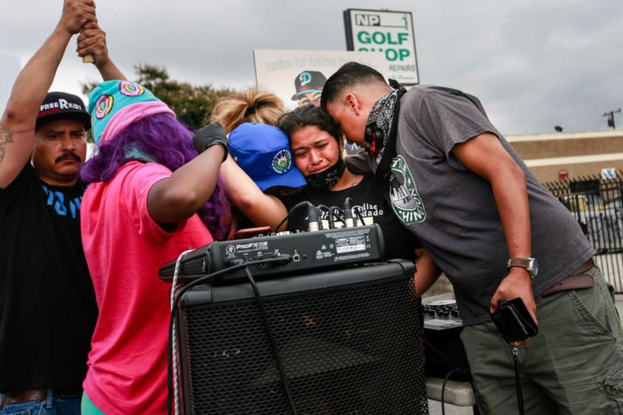 Jennifer Guardado, sister of Andres Guardado, who was fatally shot by a sheriff's deputy in Gardena, and other relatives of speak at a rally seeking justice for Andres Guardado on Sunday, June 28, 2020 in Gardena, California.
