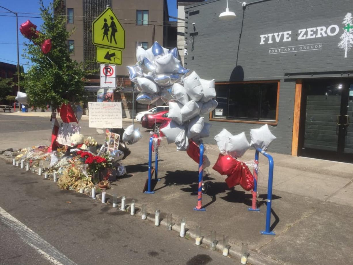 On Northeast Dekum Street, a memorial marks the site where Jordan Lee Louis, 22, was slain on July 28. His death was one of 15 homicides in Portland in July, which was the highest monthly total in 30 years.