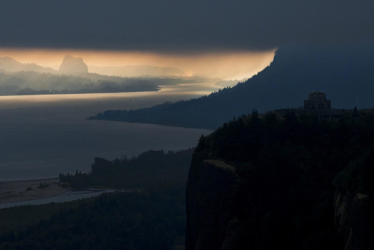 Vista House is seen here at sunrise on the Oregon side of the Columbia River Gorge on Wednesday morning, Aug. 1, 2018. (The Columbian files)