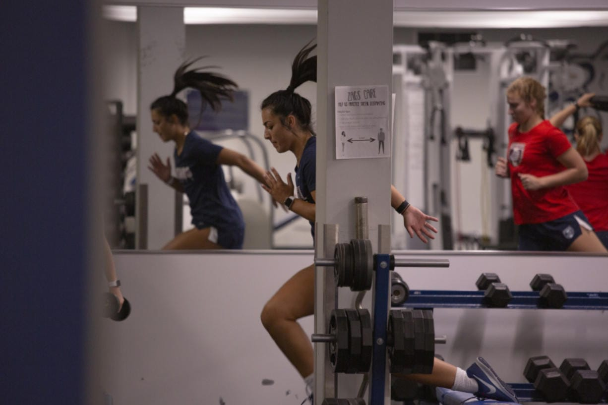Maddie Kemp goes through a drill with the Gonzaga women's soccer team, a year after suffering a serious knee injury.