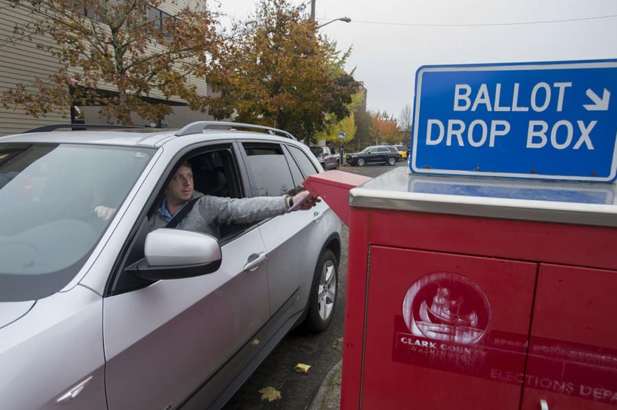 Vancouver resident Erik Hess swings by the ballot drop-off box on West 14th Street on Nov. 5, 2019.